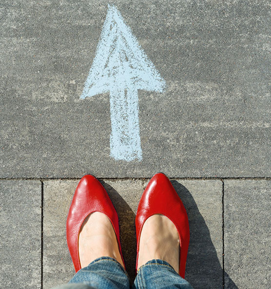 Image of arrow and red shoes